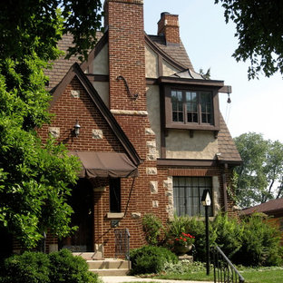 Example of a mid-sized classic multicolored three-story mixed siding gable roof design in Chicago