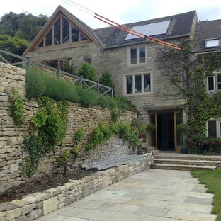 Design ideas for a medium sized modern exterior in Gloucestershire with three or more floors and stone cladding.
