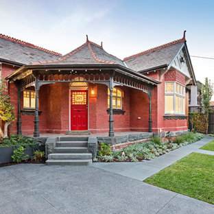 Design ideas for a victorian one-storey brick red house exterior in Melbourne with a hip roof and a shingle roof.