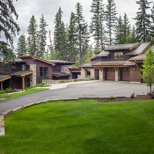 Example of a mountain style brown two-story wood exterior home design in Seattle with a shed roof