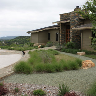Inspiration for a mid-sized contemporary gray two-story concrete fiberboard exterior home remodel in Dallas with a shed roof