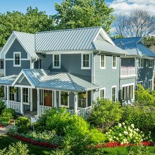 Idéer för att renovera ett lantligt blått hus, med två våningar och fiberplattor i betong