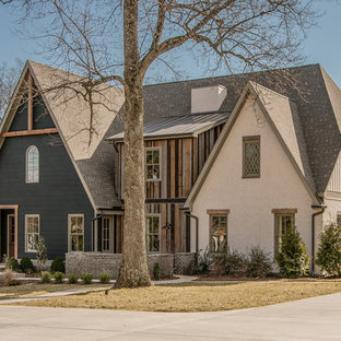 Example of a transitional wood exterior home design in Nashville
