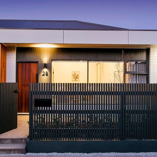 Inspiration for a mid-sized contemporary multicolored one-story vinyl duplex exterior remodel in Adelaide with a metal roof
