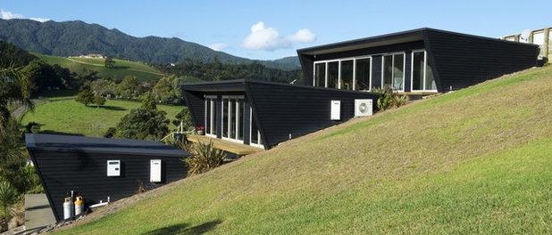 コンテンポラリー 家の外観 by Design House Architecture