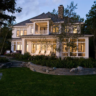 Example of a classic two-story exterior home design in Other