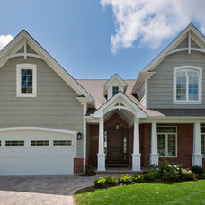 Traditional Exterior by GlobEx Developments Inc.