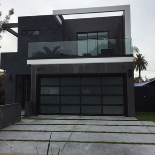 Large minimalist black two-story mixed siding exterior home photo in Los Angeles with a mixed material roof