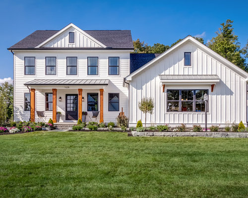 exterior home designs. example of a country white wood exterior home design in columbus with shingle roof designs