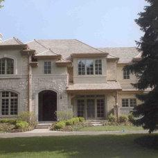 Traditional Exterior by Downey Robbins Szafarz Architects Inc.