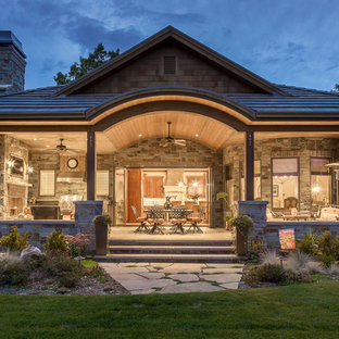 Large rustic multicolored one-story stone house exterior idea in Denver with a hip roof and a metal roof