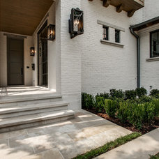 Transitional Exterior by TATUM BROWN CUSTOM HOMES