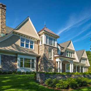 Inspiration for a timeless beige two-story wood gable roof remodel in Boston