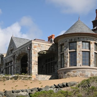 Huge ornate gray two-story stone exterior home photo in San Francisco with a gambrel roof