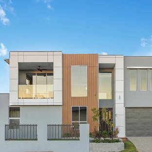 This is an example of a contemporary two-storey grey exterior in Brisbane with mixed siding and a flat roof.