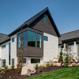 Inspiration for a transitional white two-story mixed siding gable roof remodel in Other with a shingle roof