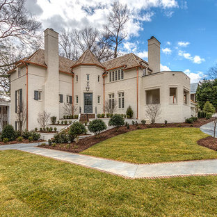 French country beige exterior home photo in Charlotte
