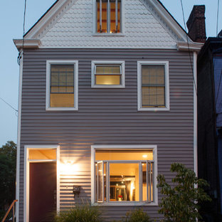 Elegant gray two-story gable roof photo in Other