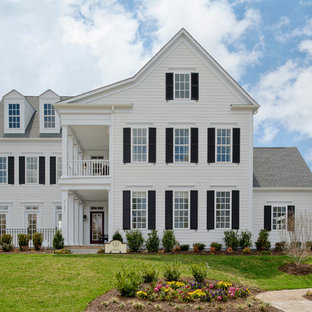 Large farmhouse white three-story wood house exterior photo in DC Metro with a shingle roof