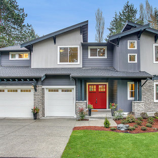 Inspiration for a contemporary gray two-story mixed siding exterior home remodel in Seattle with a shed roof