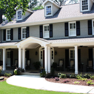 This is an example of a large traditional grey exterior in Atlanta with three or more storeys and wood siding.