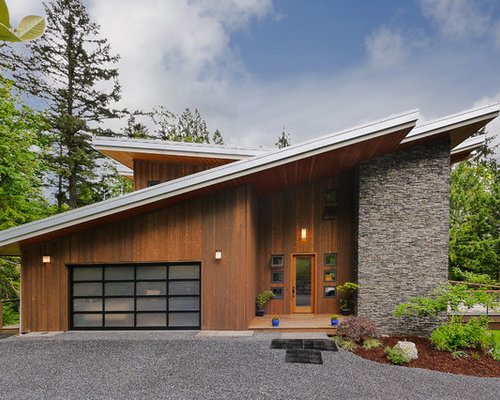 Example Of A Trendy Wood Exterior Home Design In Seattle With A Shed Roof