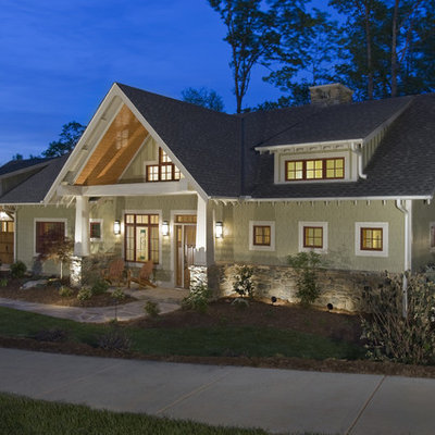 Example of an arts and crafts green exterior home design in Other