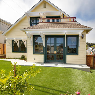Inspiration for a small timeless yellow exterior home remodel in San Francisco