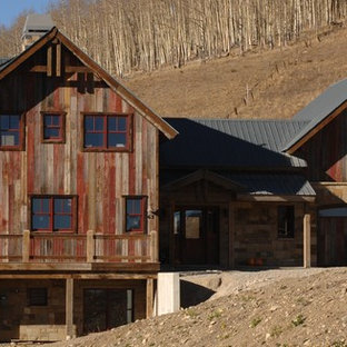 Inspiration for a large rustic brown three-story wood gable roof remodel in Denver
