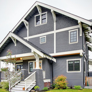 Mid-sized craftsman three-story wood gable roof idea in Seattle