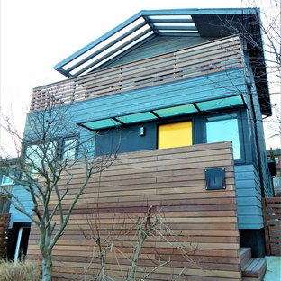 Small minimalist gray three-story wood house exterior photo in Seattle with a hip roof