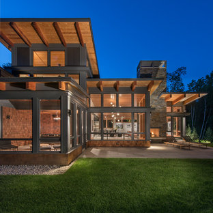 Mid-sized contemporary brown two-story wood exterior home idea in Burlington with a shed roof