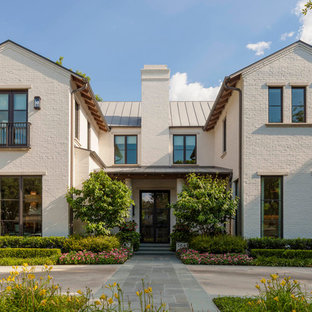 Example of a mid-sized transitional white two-story brick gable roof design in Dallas