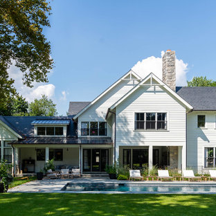 Large country white two-story mixed siding exterior home photo in New York with a shingle roof