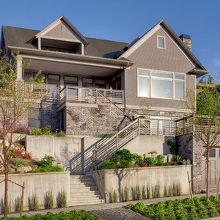 Example of a transitional gray exterior home design in Seattle