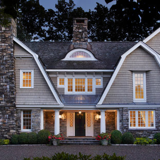 Beach style brown three-story wood exterior home idea in New York with a gambrel roof