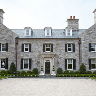 Example of a french country exterior home design in New York