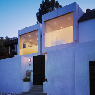Small modern white two-story stucco flat roof idea in Los Angeles