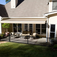 Traditional Exterior by Solair Shade Solutions