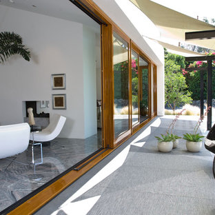Example of a trendy glass exterior home design in San Diego