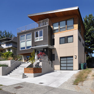 Inspiration for a mid-sized contemporary beige split-level concrete fiberboard house exterior remodel in Seattle with a shed roof
