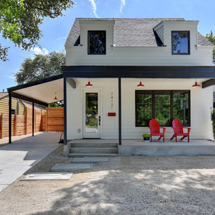 Small country white two-story wood gable roof photo in Austin