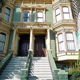 Example of a large ornate green two-story vinyl flat roof design in San Francisco