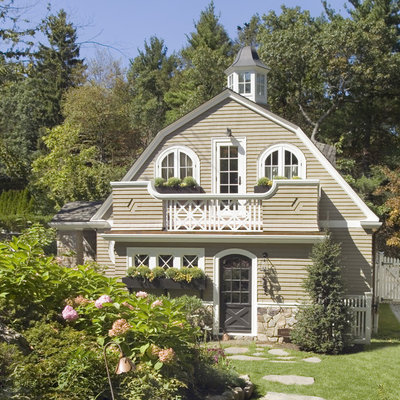 Inspiration for a mid-sized rustic beige two-story mixed siding house exterior remodel in Boston with a gambrel roof and a shingle roof