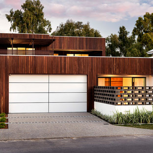 Example of a trendy wood exterior home design in Perth