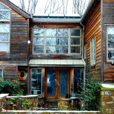 Rustic Exterior by SunPower Builders