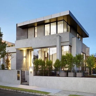 Mid-sized trendy gray three-story concrete exterior home photo in Melbourne