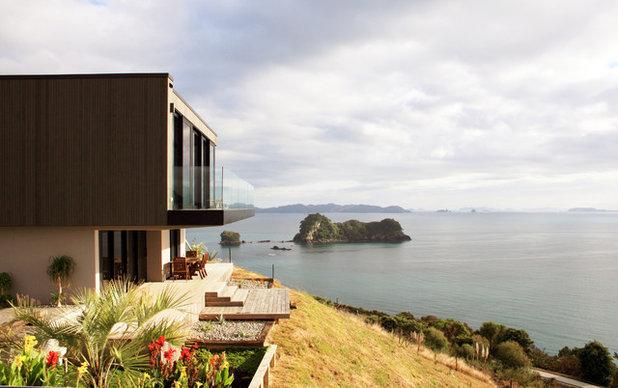Tropical Exterior by Jessop  architects Ltd