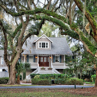 Inspiration for a huge craftsman beige two-story wood flat roof remodel in Charleston