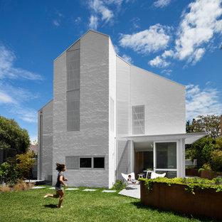 Design ideas for a scandinavian white house exterior in Melbourne.